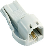 This adaptor consists of   a US-style socket to a BT-style plug  enabling you to connect US-type con
