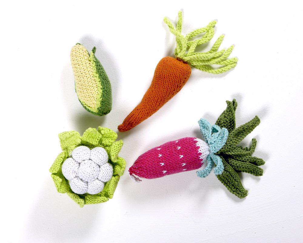 Each of these adorable fabric rattles is shaped like a different vegetable - a carrot, corn on the c