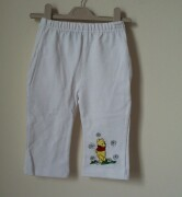 These white bootleg trousers have a lovely embroidered Winnie the Pooh on t